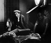 Film Director John Huston on the set of Moulin Rouge 1952 Paris, France - Ina Bandy - 1950s,1952,ACE,ACE arts,acting,actor actors,adult,adults,cinema,costume drama,culture,Directing,Director,director directors,DIRECTORS,drama,DRAMATIC,entertainment,eu,Europe,european,europeans,eurozone