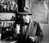 Belgian writer, Georges Simenon, in Paris, 1947. - Inge Morath - 1940s,1947,ACE,arts,author,authors,bar,bars,Belgian,cafe,cafes,catering,cities,city,culture,drink,drinker,drinkers,drinking,drinks,eu,Europe,european,europeans,eurozone,Fiction,france,french,Georges,J