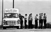 Police officers take a break from policing in the pit village of Kiveton Park to buy an ice cream from Rock on Tommy during the miners strike of 1984. - John Harris - ,1980s,1984,adult,adults,break,break time,CLJ,disputes,force,ice cream van,INDUSTRIAL DISPUTE,leisure,line,man men,MATURE,member,member members,members,MINER,miners,MINER'S,Miners' Strike,miner's stri