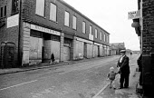 Residents go about their daily business in the deteriorating pit village of Langwith in north Derbyshire during the miners strike. - John Harris - 19-10-1984