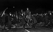 Riot police remove a barricade set up by striking miners (out of picture) in South Elmsall village after attempts earlier in the day to get one scab miner through an NUM picket line and into work at F... - John Harris - 1980s,1984,adult,adults,animal,animals,barricade,BARRICADES,CLJ,CLOSED,closing,closure,closures,DESTROYED,destruction,DISPUTE,DISPUTES,domesticated ungulate,domesticated ungulates,equestrian,equine,fo