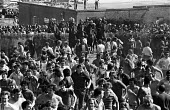 Miners start to run as police lines open and riot police officers on horseback advance towards the mass picket lines at the Orgreave coking plant during the miners strike - John Harris - 18-06-1984