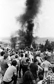 Miners create burning barricades to try and prevent further attack from riot officers on horesback after violent clashes between miners and riot police officers on the picket lines at the Orgreave cok... - John Harris - 18-06-1984
