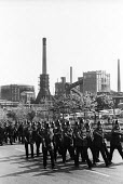 Uniformed police officers march into position during a mass picket of the Orgreave coking plant during the miners strike - John Harris - 1980s,1984,adult,adults,Battle of Orgreave,CLJ,DISPUTE,disputes,force,INDUSTRIAL DISPUTE,mass,MATURE,member,member members,members,MINER,miners,MINER'S,miners strike,miners' strike,miners strike miner