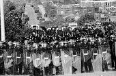 Massed ranks of police prevent striking miners from picketing lorries leaving the plant, mass picket, Orgreave coking plant, miners' strike - John Harris - 28-05-1984