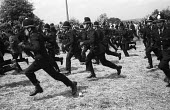 Uniformed police police officers running at full pelt during a mass picket ofthe Orgreave coking plant during the miners strike Photographer Martin Shakeshaft is the first figure on the left of the ph... - John Harris - 29-05-1984