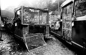 NCB coaches having grills fitted in preparation for busing in scabs as part of a back-to-work attempt across NUM picket lines during the Miners Strike, were fire-bombed overnight to prevent their use.... - John Harris - 12-08-1984