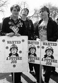 Youth at a Demonstration in Nottingham to welcome striking Kent Miners who had marched from their pits in Kent to try and persuade their fellow Nottinghamshire NUM members to stop working and join the... - John Harris - 1980s,1984,activist,activists,CAMPAIGN,campaigner,campaigners,CAMPAIGNING,CAMPAIGNS,DEMONSTRATING,Demonstration,DEMONSTRATIONS,DISPUTE,DISPUTES,INDUSTRIAL DISPUTE,job,member,member members,members,MIN