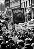 Arther Scargill portrait on the Royston Drift Branch banner. Demonstration in Nottingham to welcome striking Kent Miners who had marched from their pits in Kent to try and persuade their fellow Nottin... - John Harris - 1980s,1984,activist,activists,banner banners,CAMPAIGN,campaigner,campaigners,CAMPAIGNING,CAMPAIGNS,DEMONSTRATING,Demonstration,DEMONSTRATIONS,DISPUTE,DISPUTES,INDUSTRIAL DISPUTE,member,member members,