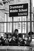 School pupils, Drummond Middle School, Bradford, 1985. Asian community perceived Headteacher Ray Honeyford as making racist remarks about his pupils. - John Harris - 1980s,1985,activist,activists,against,Asian,BAME,BAMEs,bigotry,black,BME,bmes,boy,boys,CAMPAIGN,campaigner,campaigners,CAMPAIGNING,CAMPAIGNS,child,CHILDHOOD,children,cities,city,communities,community,