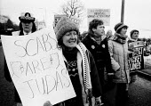Derbyshire Womens Action Group and supporters march from Markham Main to Arkwright Pit in the snow, January 1985, almost one year into the miners strike to show their continuing support. - John Harris - 18-01-1985