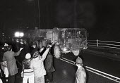 Greenham Common US Air Base outside Newbury, Berkshire. Members of Cruisewatch give a fascist salute to the drivers of a cruise missile convoy on night-time manouevres from the military base. One driv... - John Harris - 1980s,1986,a,action,activist,activists,Air force,air forces,airforce,Anti War,Antiwar,armed forces,army,atomic,base,become,campaign,Campaign for nuclear disarmament,campaigner,campaigners,campaigning,