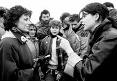 Lady Olga Maitland from the right wing group, Women & Families For Defence, arguing with a young, unemployed woman from Glasgow at a CND blockade of USAF Molesworth in Cambridgeshire one of many Ameri... - John Harris - 1980s,1986,action,activist,activists,against,airforce,American,americans,anger,angry,Anti War,Antiwar,argue,arguing,argument,armed forces,atomic,blockade,BLOCKADING,CAMPAIGN,Campaign for nuclear disar