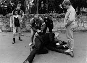 Police arrest, protest against the invitation to the South African Embassy to take part in the annual Shakespeare birthday celebrations in Stratford on Avon. Fifty countries pulled out after the organ... - John Harris - 14-04-1987