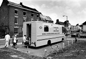 Mobile Unemployment Benefit Office in the midlands, 1988. .... - John Harris - ,1980s,1988,benefit,benefits,bicycle,BICYCLES,BICYCLING,Bicyclist,Bicyclists,bike,bikes,cycle,cycles,CYCLING,Cyclist,Cyclists,DELIVERING,delivery,Department,dole,employee,employees,Employment,FEMALE,j
