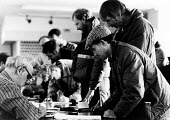 Striking Land Rover workers collect their strike pay of �20 per week and receive advice on social security from Trade Council Unemployment Centre staff in Solihull, West Midlands, 1988. - John Harris - 21-03-1988