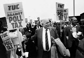 TUC Gen Sec Norman Willis at the head of a TUC national demonstration against the Poll Tax, Manchester, 1989. - John Harris - 1980s,1989,activist,activists,against,anti,banner,banners,campaign,campaigner,campaigners,campaigning,CAMPAIGNS,DEMONSTRATING,demonstration,DEMONSTRATIONS,Manchester,march,marching,member,member membe