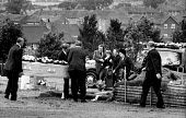 Relatives at the funeral of Jan Kaminski, one of 18 miners who died at Markham Main Colliery as a result of a lift shaft accident at the pit on 30th July, 1973. - John Sturrock - &,1970s,1973,accident,accidental,accidents,accidents at work,adult,adults,assisting,at,Belief,burial,bury,burying,casket,Cemeteries,Cemetery,christian,christianity,church,churches,churchyard,churchyar
