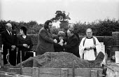 Relatives at the funeral of Jan Kaminski, one of 18 miners who died at Markham Main Colliery as a result of a lift shaft accident at the pit on 30th July, 1973. - John Sturrock - &,1970s,1973,a,accident,accidental,accidents,accidents at work,adult,adults,assisting,at,bearer,bearers,belief,burial,bury,burying,casket,Cemeteries,cemetery,christian,christianity,church,churches,chu