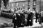 Relatives after the funeral of Jan Kaminski, one of 18 miners who died at Markham Main Colliery as a result of a lift shaft accident at the pit on 30th July, 1973. - John Sturrock - 1970s,1973,accident,accidental,accidents,accidents at work,adult,adults,assisting,at,bury,burying,Coal Mine,coalfield,collieries,colliery,comfort,comforting,cry,crying,dead,death,deaths,dia,died,disas
