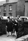 Relatives after the funeral of Jan Kaminski, one of 18 miners who died at Markham Main Colliery as a result of a lift shaft accident at the pit on 30th July, 1973. - John Sturrock - 1970s,1973,accident,accidental,accidents,accidents at work,adult,adults,assisting,at,bury,burying,Coal Mine,coalfield,collieries,colliery,cry,crying,dead,death,deaths,dia,died,disaster,DISASTERS,emoti