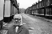 Old woman walking terraced street in Liverpool in the mid-1970s - John Sturrock - 06-11-1974