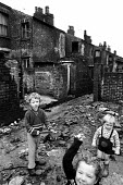 Children playing at the rear of terraced housing in the process of being pulled down in Liverpool in the mid-1970s - John Sturrock - 06-11-1974