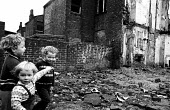 Children playing at the rear of a block of terraced housing in the process of being pulled down in Liverpool in the mid-1970s. - John Sturrock - 06-11-1974