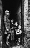 Mother with her children in the doorway of their terraced house in Liverpool in the mid-1970s - John Sturrock - 06-11-1974