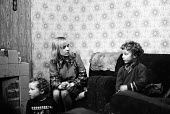 Mother with her children in terraced housing in the Liverpool in the mid-1970s - John Sturrock - 06-11-1974