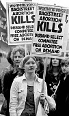Demonstration in favour of abortion rights, free abortion on demand and against SPUC, Backstreet abortion kills, 1975, London. - John Sturrock - 1970s,1975,abortion,activist,activists,against,backstreet,CAMPAIGN,campaigner,campaigners,CAMPAIGNING,CAMPAIGNS,choose,demand,DEMONSTRATING,DEMONSTRATION,DEMONSTRATIONS,equal rights,equality,female,fe
