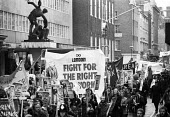 Right To Work march passes by TUC headquarters, which had been occupied by campaigners just the day before, London, 1975. - John Sturrock - 1970s,1975,activist,activists,against,banner,banners,campaign,campaigner,campaigners,campaigning,CAMPAIGNS,Congress House,DEMONSTRATING,demonstration,DEMONSTRATIONS,headquarters,HQ,jobless,jobseeker,j
