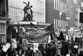Members of the Gay Liberation Front and Rolls Royce on the Right To Work march as it passes by TUC headquarters, which had been occupied by campaigners just the day before, London, 1975. - John Sturrock - ,1970s,1975,activist,activists,against,banner,banners,campaign,campaigner,campaigners,campaigning,CAMPAIGNS,Congress House,DEMONSTRATING,demonstration,DEMONSTRATIONS,Gay,headquarters,HQ,jobless,jobsee