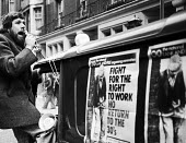 Ricky Tomlinson speaking as the Right To Work march passes by TUC headquarters, London, 1975 - John Sturrock - 1970s,1975,activist,activists,against,campaign,campaigner,campaigners,campaigning,CAMPAIGNS,cities,city,Congress House,DEMONSTRATING,demonstration,DEMONSTRATIONS,headquarters,HQ,jobless,jobseeker,jobs