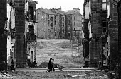 A mother and father take their baby for a walk in its pram in the run down Maryhill district of Glasgow in the summer of 1976 - John Sturrock - 1970s,1976,babies,Baby,bleak,child,CHILDHOOD,children,cities,city,clearance,CLEARENCE,conditions,demolish,DEMOLISHED,demolishing,demolition,derelict,DERELICTION,developer,developers,DEVELOPMENT,EARLY