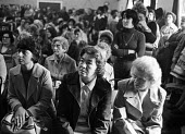 Mass meeting of women from TRICO on strike for Equal Pay in 1976. - John Sturrock - 1970s,1976,AUEW,campaign,campaigning,CAMPAIGNS,disputes,Equal Pay,equality,fair pay,female,INDUSTRIAL DISPUTE,London,Mass,meeting,MEETINGS,member,member members,members,metropolitan,people,person,pers