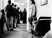 Queueing at the Employment Exchange 1977, Middlesbrough - John Sturrock - 1970s,1977,adult,adults,benefit,benefits,Benefits Office,child,CHILDHOOD,children,dole,EARLY YEARS,employee,employees,Employment,Employment Exchange,Exchange,FAMILY,female,females,girl,girls,interacti
