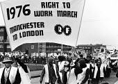 The Right To Work March passing through Manchester en route to Oldham in the north west of England. - John Sturrock - 1970s,1976,activist,activists,BAME,BAMEs,banner,banners,black,BME,bmes,campaign,campaigner,campaigners,campaigning,CAMPAIGNS,DEMONSTRATING,demonstration,DEMONSTRATIONS,diversity,ethnicity,jobless,jobs