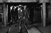 Miners coming off shift at Cwm Coedely Colliery in the South Wales coalfields, 1976. - John Sturrock - 27-11-1976