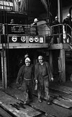 Miners coming off shift with Safety signs, Cwm Coedely Colliery in the South Wales coalfields, 1976. - John Sturrock - 27-11-1976