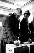 Miners vote in workplace ballots on early retirement prior to going on shift, Snowdon Colliery, Kent, 1976. - John Sturrock - 08-12-1976