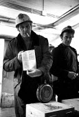 Miner votes yes in workplace ballots on early retirement prior to going on shift, Snowdon Colliery, Kent, 1976. - John Sturrock - 08-12-1976