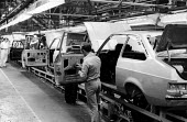 The car production assembly line at Ford Halewood in LIverpool. - John Sturrock - 1970s,1977,assembly,AUTO,auto industry,AUTOMOBILE,AUTOMOBILES,automotive,capitalism,capitalist,car,Car Industry,car worker,carindustry,cars,EBF,Economic,Economy,employee,employees,Employment,Ford,Indu