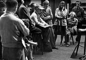Artist Andre Lhote instructing his students at a life drawing art class, London, 1947. .... - Lallah Churchill - 1940s,1947,ACE,Andre,art,artist,artists,arts,artwork,artworks,cities,city,class,communicating,communication,conversation,conversations,culture,dialogue,discourse,discuss,discusses,discussing,discussio