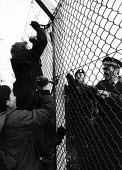 Greenham Common. Soldiers and security staff are unable to prevent women peace campaigners using bolt cutters to enter the US air base as part of their campaign of direct action for peace and against... - Melanie Friend - 1980s,1983,action,activist,activists,against,Air force,air forces,airforce,Anti War,anti-nuclear,Antiwar,armed forces,army,atomic,Barbed Wire,breach,CAMPAIGN,Campaign for nuclear disarmament,campaigne