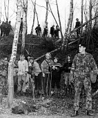 Greenham Common. Soldiers stand guard over women who successfully entered the US air base as part of their campaign of direct action for peace and against nuclear weapons held at the site. - Melanie Friend - 1980s,1983,action,activist,activists,against,Air force,air forces,airforce,Anti War,anti-nuclear,Antiwar,armed forces,army,atomic,breach,camouflage,CAMPAIGN,Campaign for nuclear disarmament,campaigner