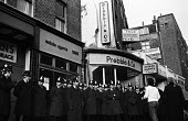 Police lines outside the offices of the Islington estate agents, Prebble, protecting them from the anger of a protest against their active role in the removal of Islington tenants from their homes to... - Mike Sheridan - 07-12-1974