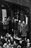 Sir Winston Churchill's Funeral. Opposite St Paul's Cathedral, crowds gather to show their respect. - Michael Taylor - 1960s,1965,British people,Cathedral,CATHEDRALS,Churchill,crowd crowded,funeral,FUNERALS,gathering,man men,POL politics,show,state funeral,urban city