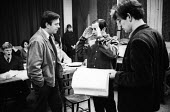 Playwright & Director, Arnold Wesker, during rehearsals for his plays, Their Very Own and And Golden City, Royal Court Theatre, London, 1966. ~On right of photo with script in hand is Ian McKellen. - Patrick Eagar - 1960s,1966,ACE,act,acting,actor,actors,adult,adults,Arnold,arts,author,authors,cities,city,Court,culture,directing,director,directors,drama,DRAMATIC,Entertainment,London,maker,makers,making,male,man,M