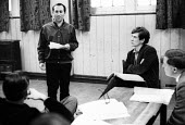 Playwright & Director, Arnold Wesker, during rehearsals for his plays, Their Very Own and And Golden City, Royal Court Theatre, London, 1966. ~Seated to Wesker's left is Ian McKellen. - Patrick Eagar - 1960s,1966,ACE,act,acting,actor,actors,adult,adults,Arnold,arts,author,authors,cities,city,Court,culture,directing,director,directors,drama,DRAMATIC,Entertainment,Ian,London,maker,makers,making,male,m